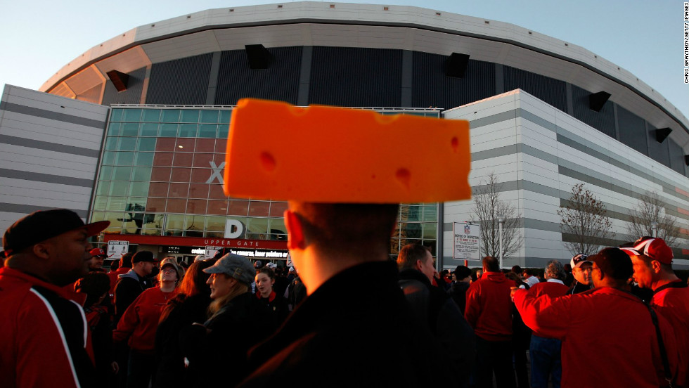 A Green Bay Packers fan (known as a cheesehead) waits to enter the Georgia Dome in Atlanta before the 2011 Green Bay Packers vs. Atlanta Falcons divisional playoff.