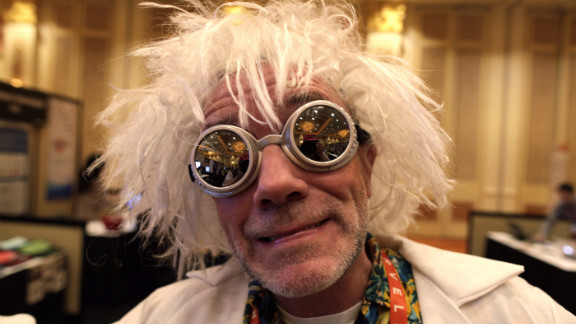 """An exhibitor dressed as Doc Brown from the """"Back to the Future"""" movies greets people at the Securifi booth at the Consumers Electronic Show in Las Vegas. The annual event is the largest gadget conference in the world. Check out photographer Zoran Milich's take on the action."""