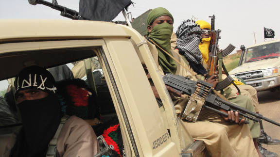 A photo taken on August 7 shows fighters of the Islamic group Ansar Dine standing guard at Kidal airport, northern Mali.