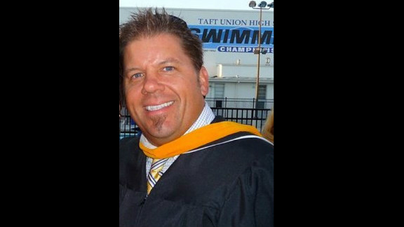 Authorities say teacher Ryan Heber helped talk the gunman into handing over his weapon.