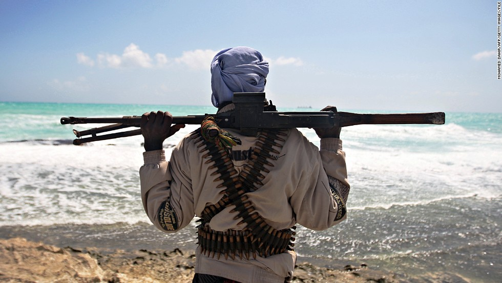 A World Bank study says pirates off Somalia could cost the global economy $18 billion as shippers are forced to change trading routes and pay higher insurance premiums.<br />Pictured, an armed pirate near Hobyo town, northeastern Somalia, in January 2010.