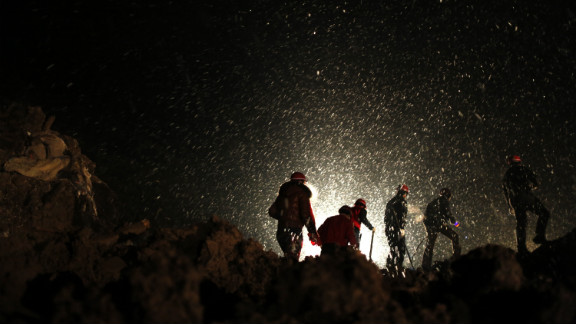 Rescuers on Friday, January 11, begin searching for missing residents in disaster-hit Gaopo village in southwest China. A landslide struck Friday morning, triggered by rain and snow that had saturated the largely rocky area for 10 days, Li Lianju, deputy director of the Yunnan Land and Resources Department, told state media.