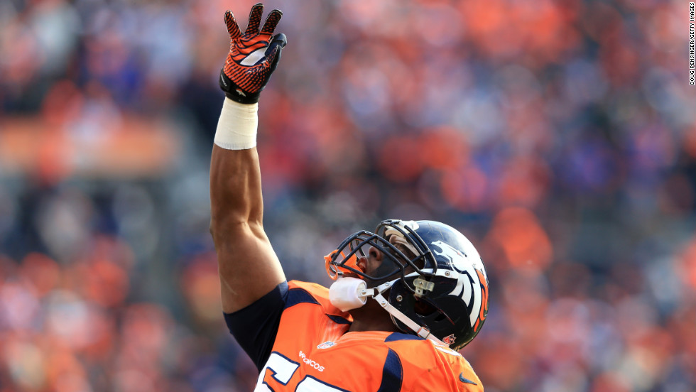Denver's Steven Johnson gestures to the sky after a play.