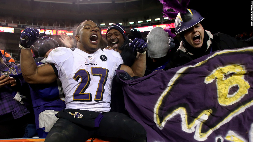 Ray Rice celebrates with some of the Ravens fans in Denver after Saturday's win.