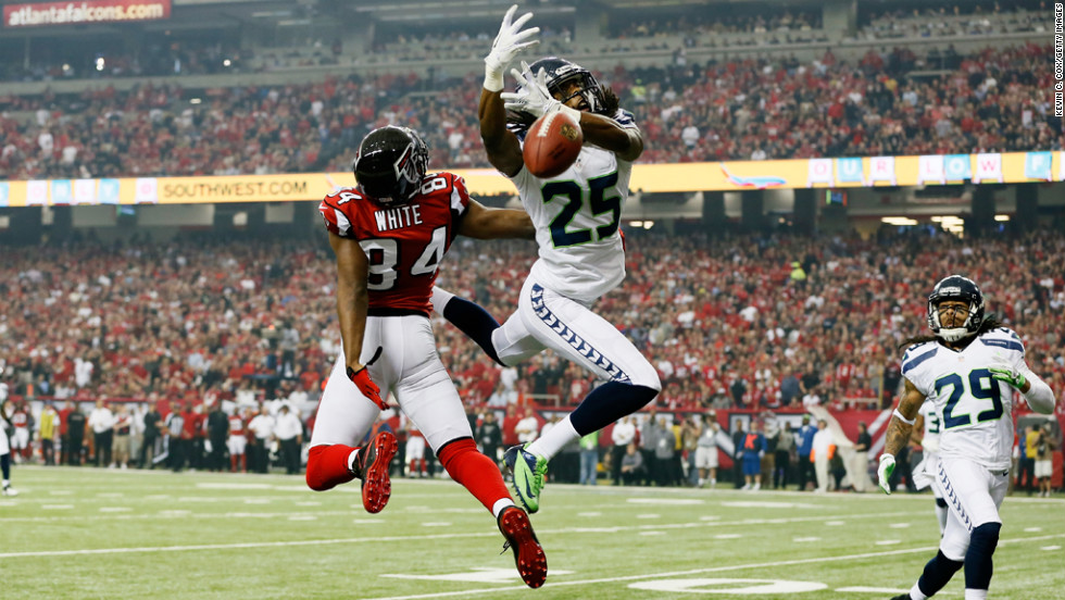 Richard Sherman of the Seahawks breaks up a pass intended for Roddy White of the Falcons on Sunday.