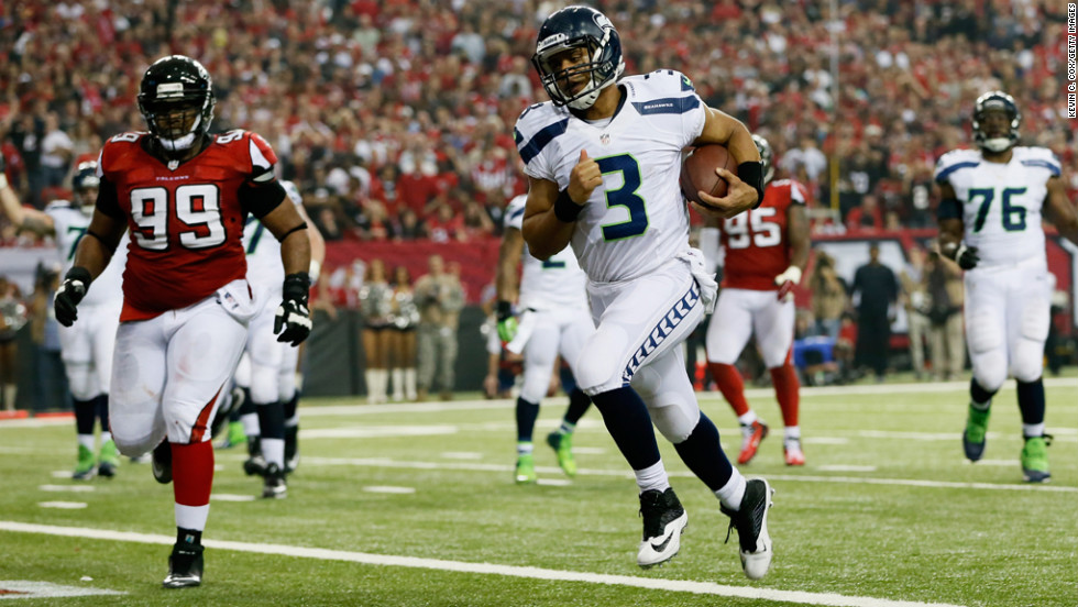 Russell Wilson of the Seahawks runs the ball in for a fourth quarter touchdown against the Falcons on Sunday.
