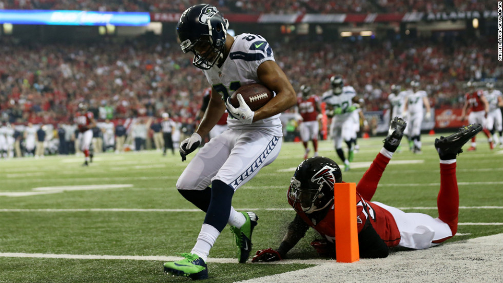 Golden Tate of the Seahawks runs a reception in for a third quarter touchdown against Thomas DeCoud of the Falcons on Sunday.