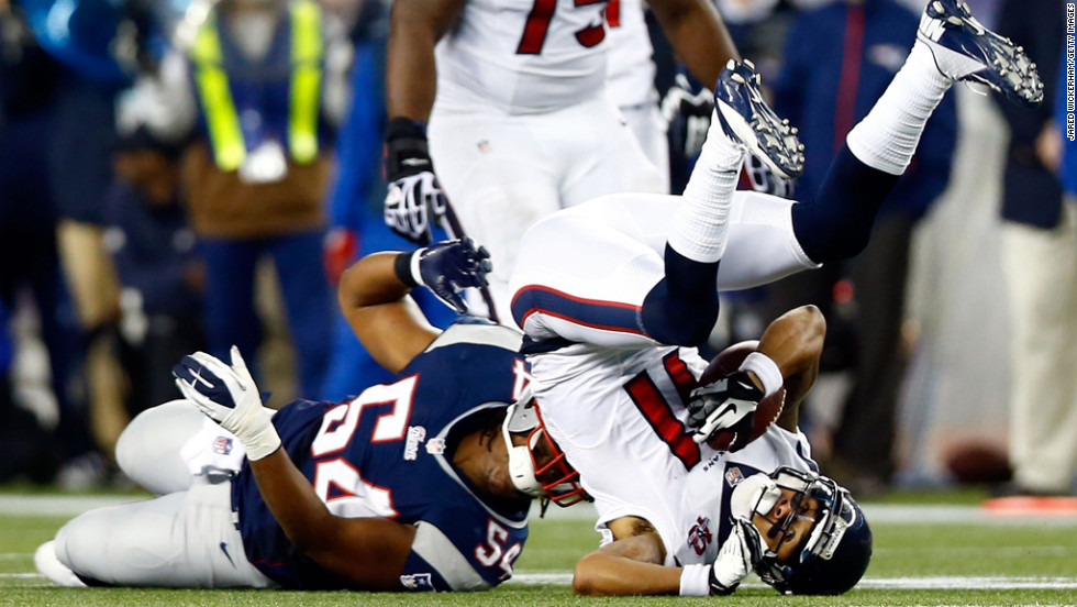 Dont'a Hightower of the New England Patriots tackles DeVier Posey of the Houston Texans.