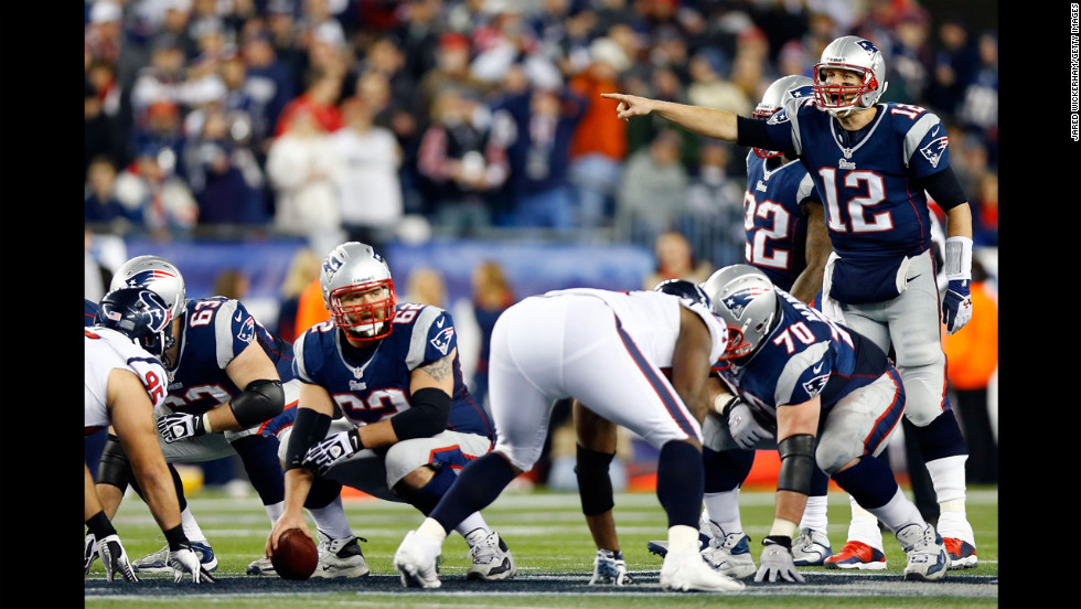 Patriots quarterback Tom Brady makes an adjustment during Sunday's game against the Houston Texans.