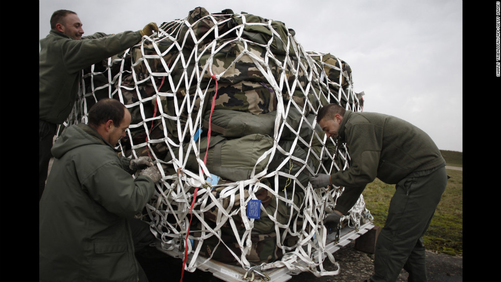 French soldiers prepare cargo for a British plane en route to Bamako on Sunday at the Evreux military base.