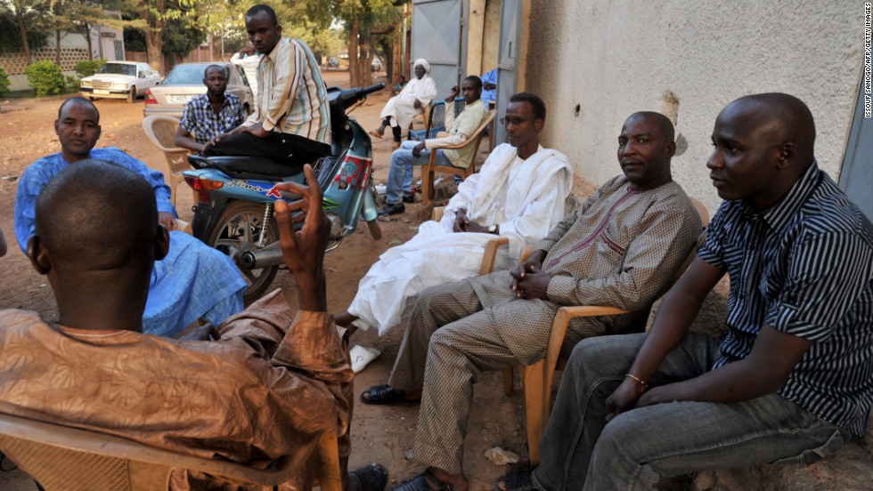 Internally displaced Malians from Timbuktu chat at a makeshift cafe in Bamako on Sunday.