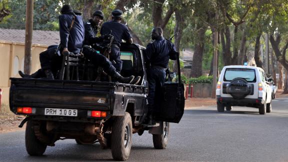 Malian police patrol Bamako on Sunday.