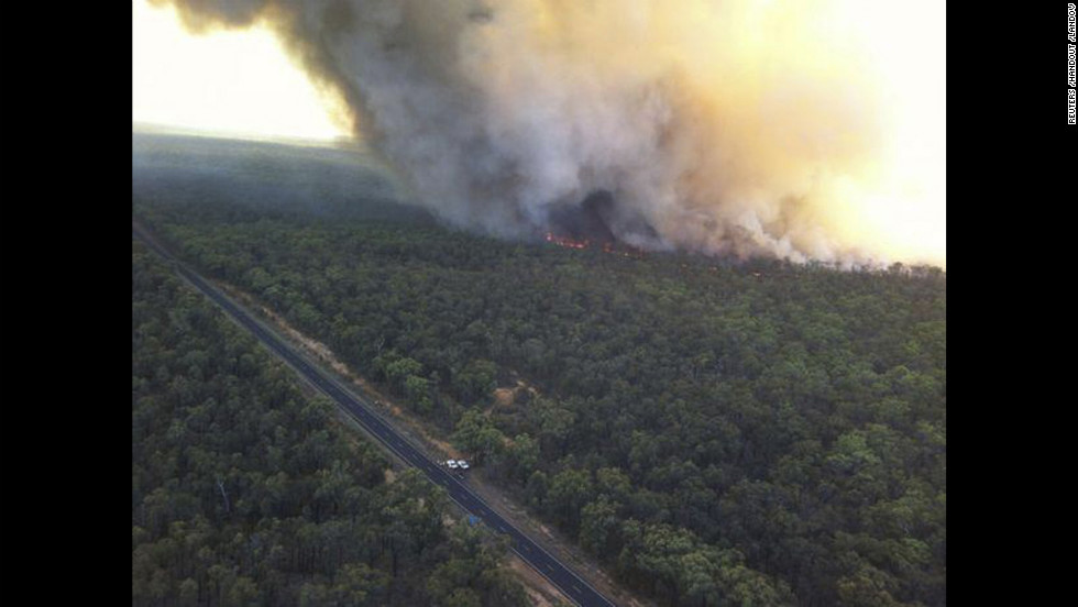 The Redbank North Fire burns close to the Newell Highway near Coonabarabran on Monday.