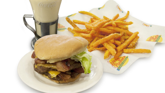 Where to start? The Johnny Rockets bacon cheddar double burger is 1,770 calories with its white bun, two beef patties, four cheese slices, four strips of bacon and a sauce. As a comparison, three McDonald