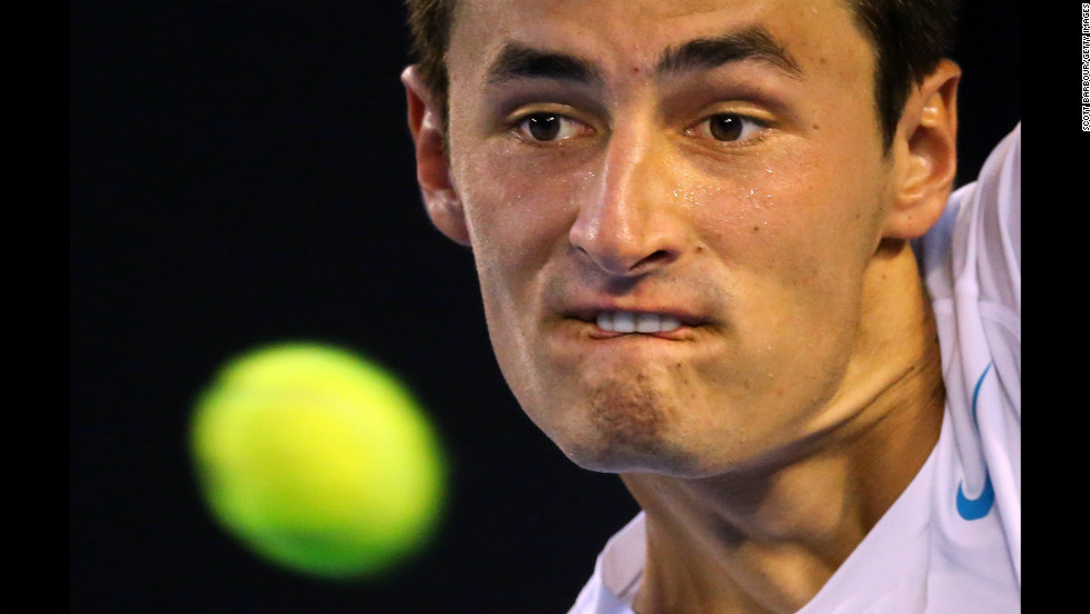 Bernard Tomic of Australia plays a backhand in his first-round match against Leonardo Mayer of Argentina on January 15. Tomic defeated Mayer 6-3, 6-2, 6-3.