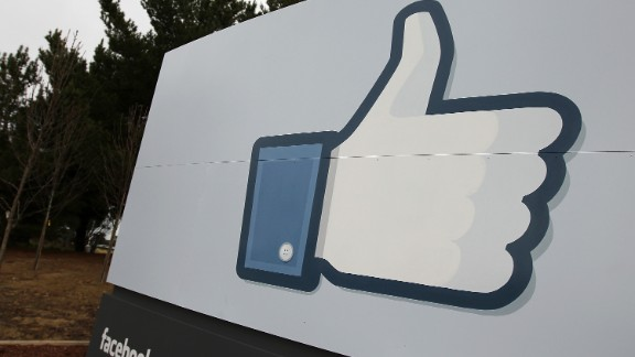 A sign with the 'like' symbol stands in front of Facebook headquarters in Menlo Park, California on February 1, 2012.