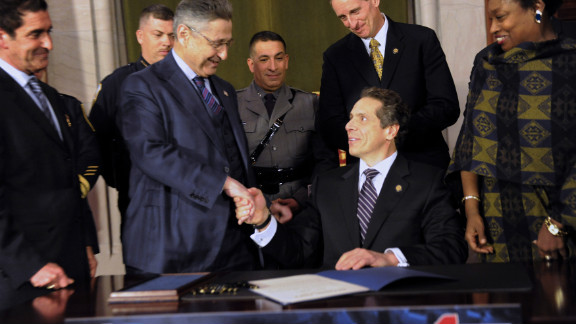 Former Assembly Speaker Sheldon Silver, left, shakes hands with Gov. Andrew Cuomo after the signing of a gun bill in 2013.