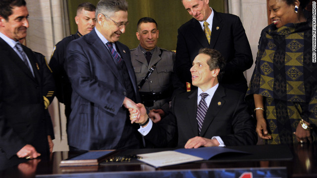 Assembly Speaker Sheldon Silver and others congratulate New York Governor Andrew Cuomo after he signed the New York Secure Ammunition and Firearms Enforcement Act at the Capitol in Albany in 2013. REUTERS/Hans Pennink