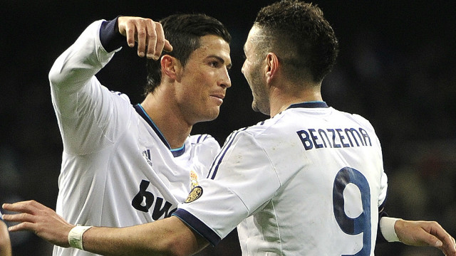 Cristiano Ronaldo (L) congratulates Karim Benzema after the French striker opened the scoring against Valencia