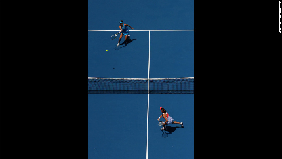 Irina-Camelia Begu of Romania, left, plays a forehand in her second round match against Agnieszka Radwanska of Poland on January 16. Radwanska won 6-3 6-3.