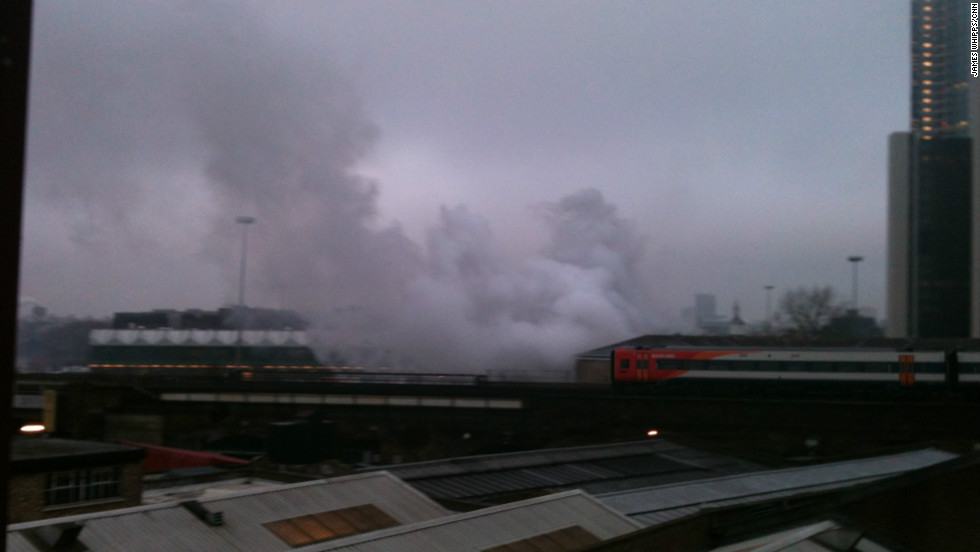 Smoke billows over central London's Vauxhall Cross area after a helicopter crash on the morning of January 16.
