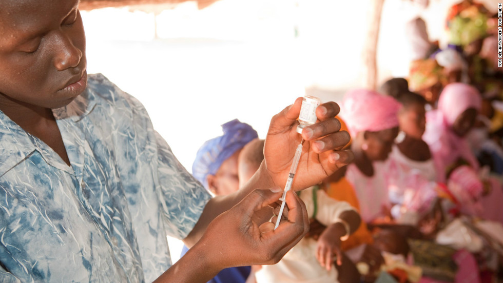 A nurse at an outreach clinic in The Gambia prepares a vaccination.