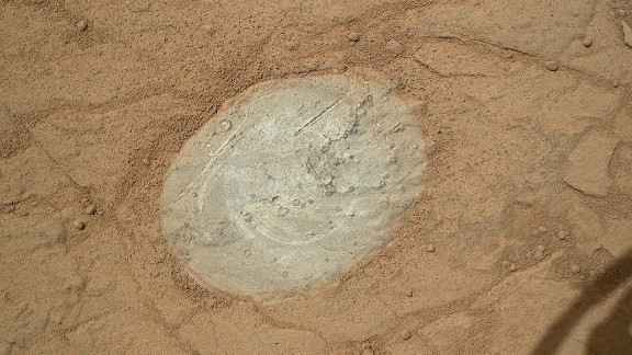 Curiosity used a dust-removal tool for the first time to clean this patch of rock on the Martian surface on January 6, 2013.