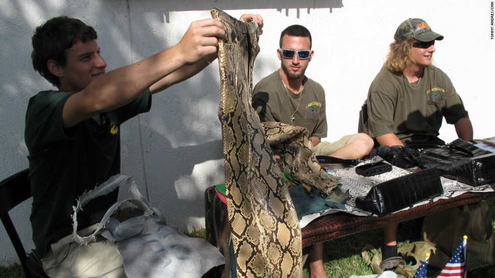 Chris Wood's (far right) family business All American Gator offered participants an opportunity to turn their catches into just about anything, even pants. The pair held in this photo cost $3,000. The company is also offering to pay for snake hides and is offering a bonus prize for the biggest skins.