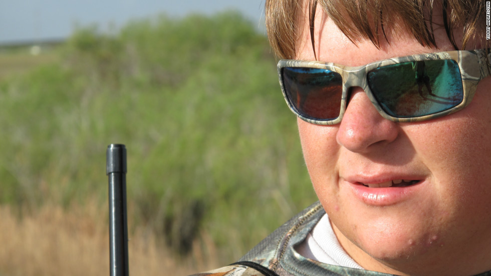 Coby Pawlowski surveys the land with a .22-caliber rifle on his shoulder. The 17-year-old is one of the youngest participants in the 2013 Python Challenge and is accompanied by his father Bob Pawlowski and his friend, 17-year-old Jimmy Harper.