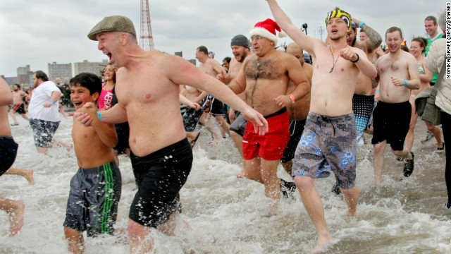 People run into the water for Coney Island Polar Bear Club's New Year's Day swim in 2013.