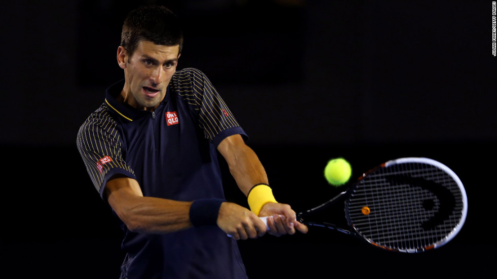 Novak Djokovic of Serbia plays a backhand in his second round match against Ryan Harrison of USA during on Wednesday, January 16. Djokovic defeated Harrison 6-1, 6-2, 6-3.
