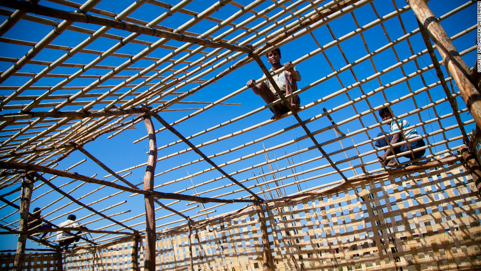 "With thousands of families living in tents and makeshift shelters, providing improved shelter is a humanitarian priority. Workers recruited both from the camps and nearby villages are constructing ""long houses,"" each of which will house eight or 10 families, as temporary shelters in the camps."