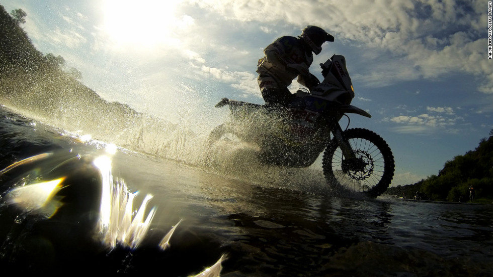 A biker competes rides through water on January 15.