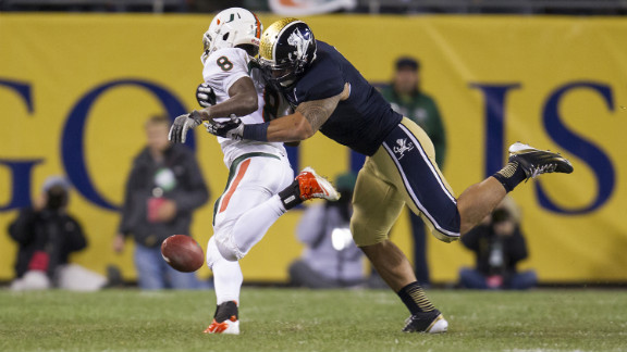 Te'o tackles Miami running back Duke Johnson during the Fighting Irish game against the Miami Hurricanes in Chicago on October 6. Notre Dame defeated Miami 41-3.