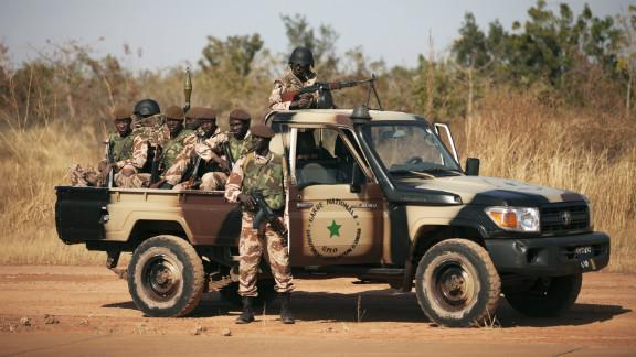 Malian soldiers stand guard as Mali