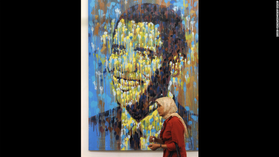 INDONESIA: A woman walks past a portrait of Obama at an exhibition in Jakarta, Indonesia, on July 30, 2010.