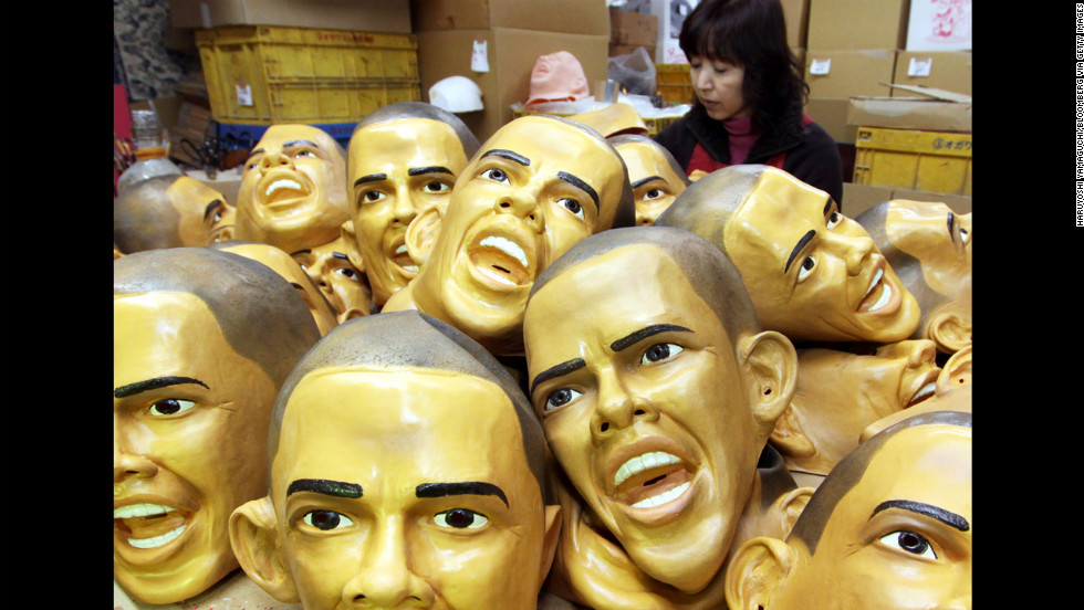 JAPAN: Fusako Moriya, an employee of Ogawa Studios Co. Ltd., paints an eye on a rubber mask of Obama at the company's factory in Saitama city, Japan, on January 20, 2009.