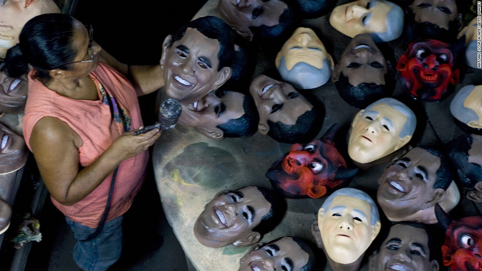 BRAZIL: A worker of the Condal Carnival Mask Factory inspects a mask portraying Obama in Sao Goncalo, on February 10, 2009.