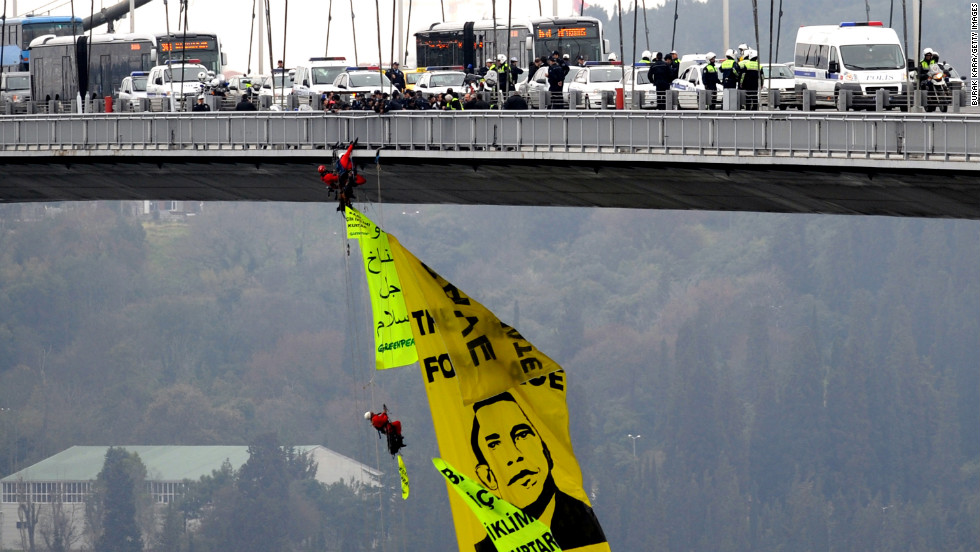 TURKEY: Greenpeace activists open a banner depicting Obama on Bosphorus Bridge on April 6, 2009, in Istanbul.