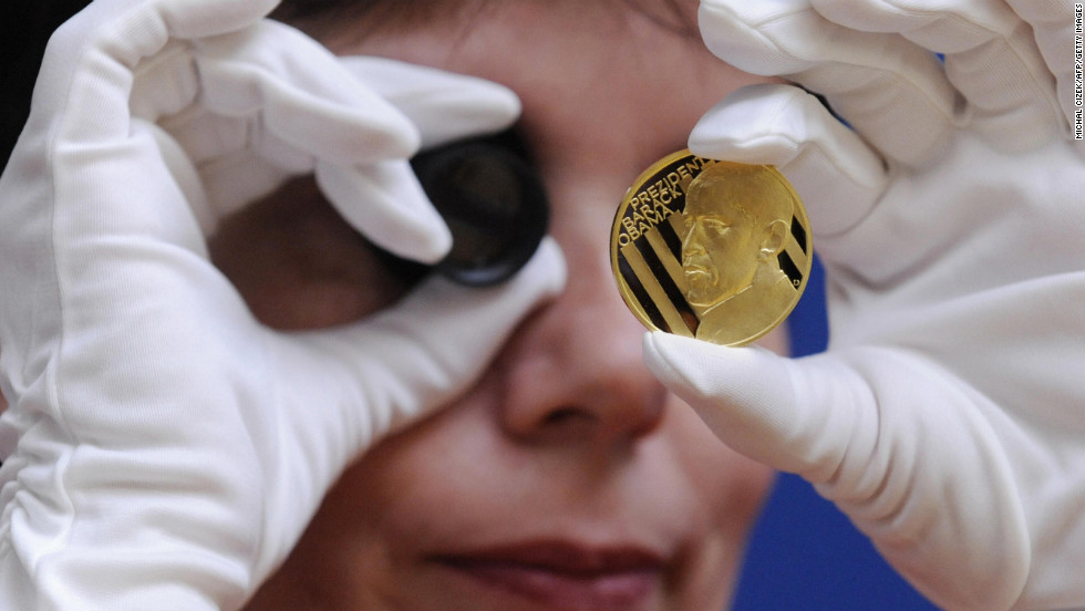 CZECH REPUBLIC: An employee of the Jablonex mint checks the quality of a commemorative gold medal featuring Obama on March 31, 2009, in Jablonec nad Nisou.