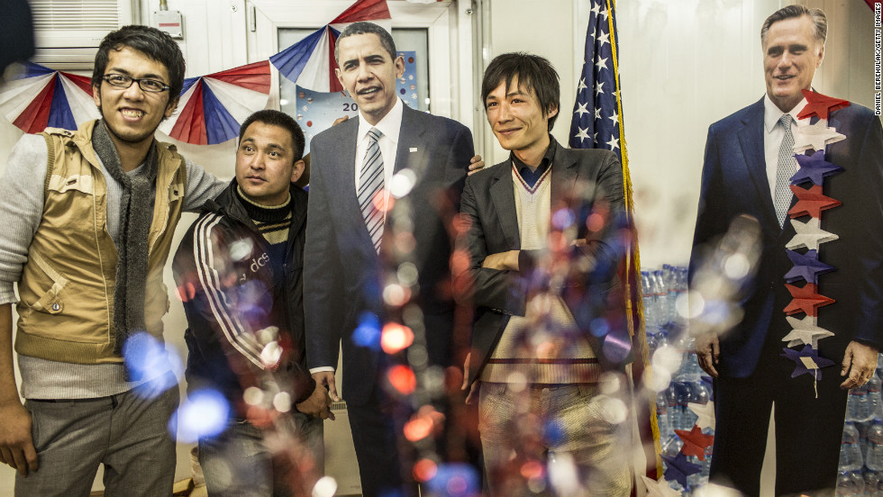 AFGHANISTAN: Afghan journalists pose with cardboard cutouts of Obama and Mitt Romney during an election event at the U.S. Embassy on November 7, 2012, in Kabul.