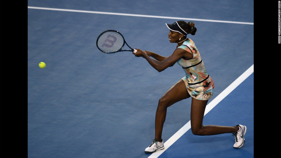 Williams hits a return against Sharapova on January 18.