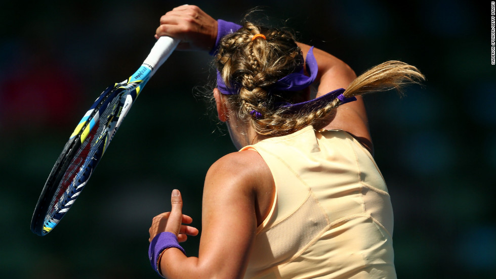 Victoria Azarenka of Belarus plays a forehand in her third-round match against Jamie Hampton of the United States.