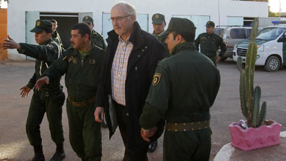 Freed Norwegian hostage Oddvar Birkedal is escorted at a police station in Amenas, Algeria, on Saturday.