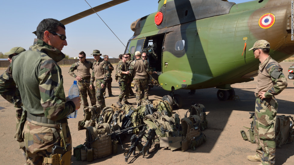 French soldiers of the 5th Combat Helicopter Regiment stand with their equipment in front of a helicopter on January 19 at an airbase near Bamako, Mali. French Defense Minister Jean-Yves Le Drian said on January 19 that France now had 2,000 troops on the ground in Mali as part of a drive against Islamist militants holding the north of the country.