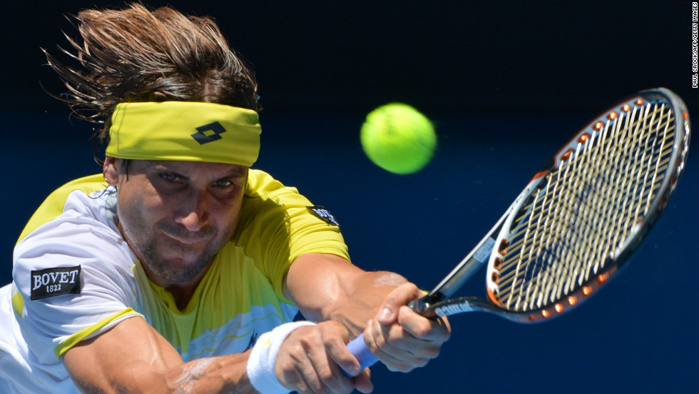 Spain's David Ferrer hits a return against Japan's Kei Nishikori during their men's singles match on January 20. Ferrer won 6-2, 6-1, 6-4.