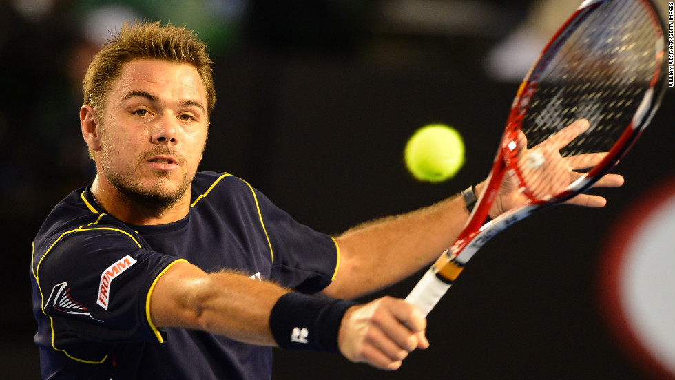 Stanislas Wawrinka of Switzerland plays a return during his men's singles match against Serbian Novak Djokovic on Sunday, January 20, Day Seven of the Australian Open in Melbourne, Australia. Wawrinka lost 1-6, 7-5, 6-4, 6-7 (5), 12-10.
