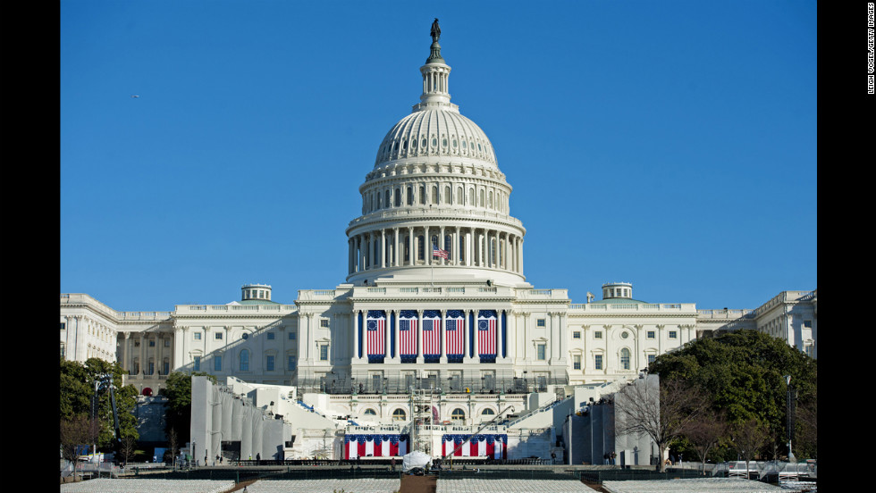 Workers prepare the U.S. Capitol for the swearing-in ceremony on Friday.