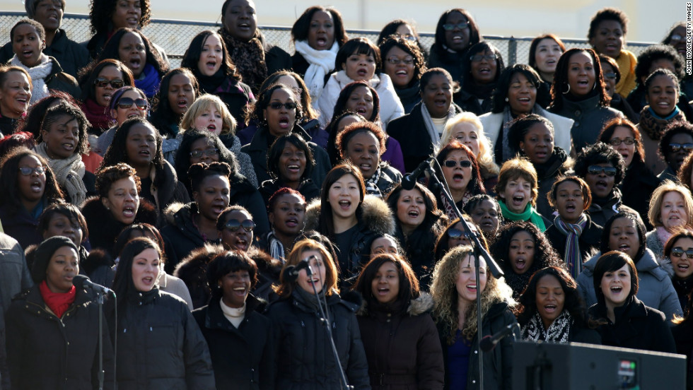 A chorus rehearses at the U.S. Capitol building on Sunday.