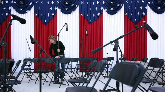 A stage technician from Maryland Sound International sets up microphones for the presidential inauguration at the West Front of the U.S. Capitol on Sunday.
